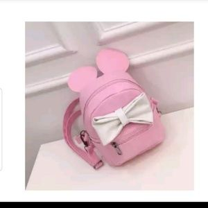 Minnie mouse pink faux leather mini backpack w/bow
